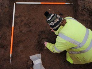 Excavation of a Bronze Age plain urn at Barrassie