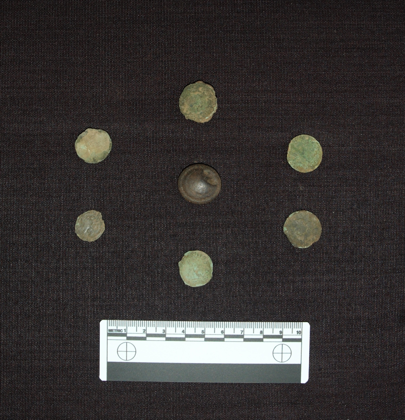 Six of the medieval coins and one of the gaming counters recovered from Netherton Cross